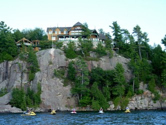 Photo of one of Muskoka's awesome cottages on Muskoka Sea Doo tour