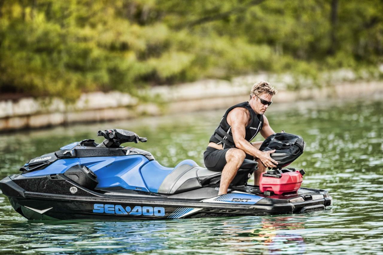 Rider installing LinQ sustem Sea Doo Storage